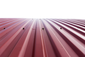 Rooftop of curved red corrugated iron on white background